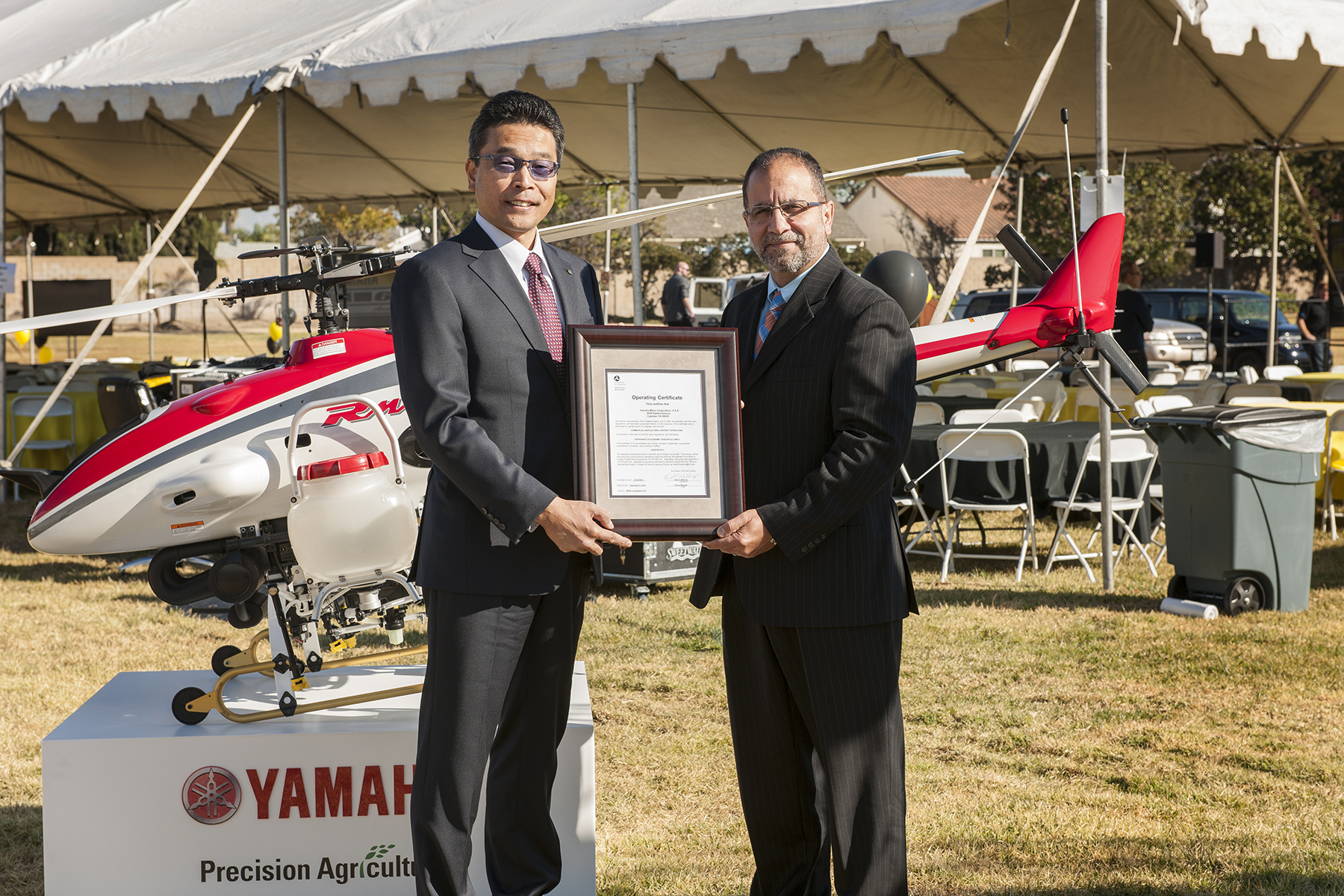 Terry_Okawa_left_president_Yamaha_Motor_Corpora-10b2ac63a174b2f2a7732a3c3adb3a59 Yamaha Gets FAA Certification for RMAX Unmanned Helicopter